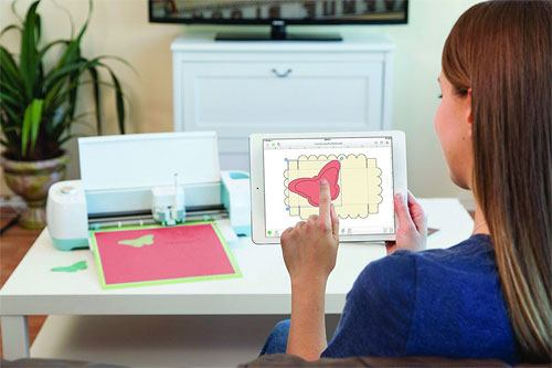 Woman Sending Design From Tablet To Cutter